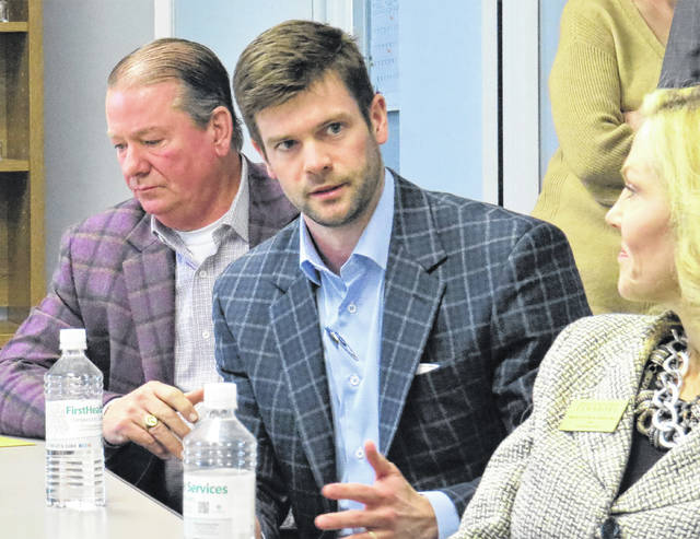 Gavin Stone | Daily Journal Neil Robinette, CEO of C.F. Smith Property Group, speaks to Congressman Dan Bishop during a visit at the Richmond County Chamber of Commerce on Thursday.