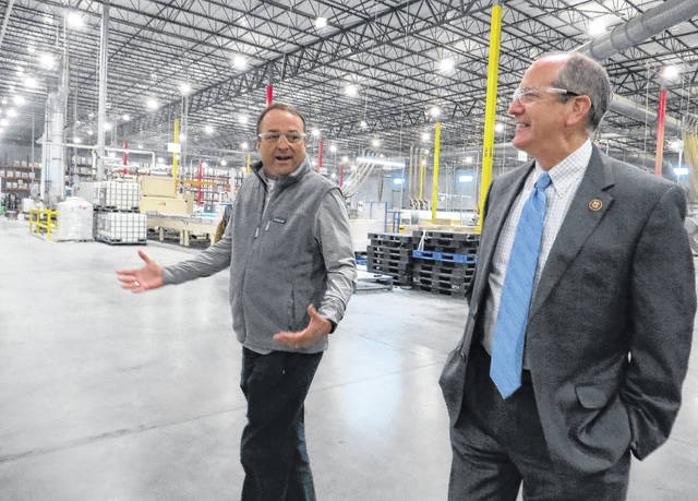 Gavin Stone | Daily Journal Bob Young, director of operations for the American Woodmark plant in the Richmond County Industrial Park, gives Congressman Dan Bishop a tour of the plant on Thursday.