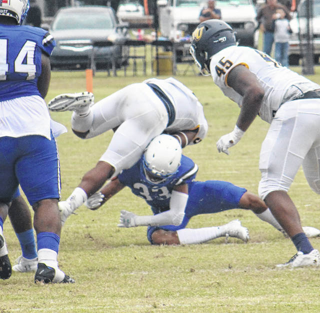 Brandon Tester | Laurinburg Exchange file photo St. Andrews defensive back Demarche Hilliard (33) makes a tackle during a football game last year. The Knights have had to adjust their spring workout plans because of the COVID-19 pandemic.