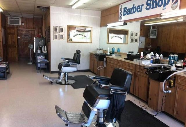 Personal care facilities like Rockingham Barber Shop (pictured) will be able to open at 50% capacity as of 5 p.m. on Friday.