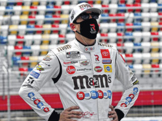 AP Photo | Gerry Broome                                 Driver Kyle Busch watches during qualifying for the NASCAR Cup Series race at Charlotte Motor Speedway on Sunday.