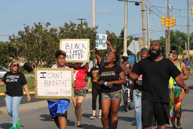 George McNeill, right, and other protesters called for an end to racial profiling and for more police accountability on Sunday.