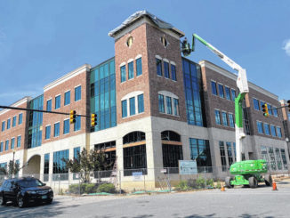 Brandon Tester   Daily Journal                                 The projected completion date for the new Robinette Building in downtown Rockingham has been pushed back to July 10. The Robinette Building will house Leon Levine School of Business and Information Technology.
