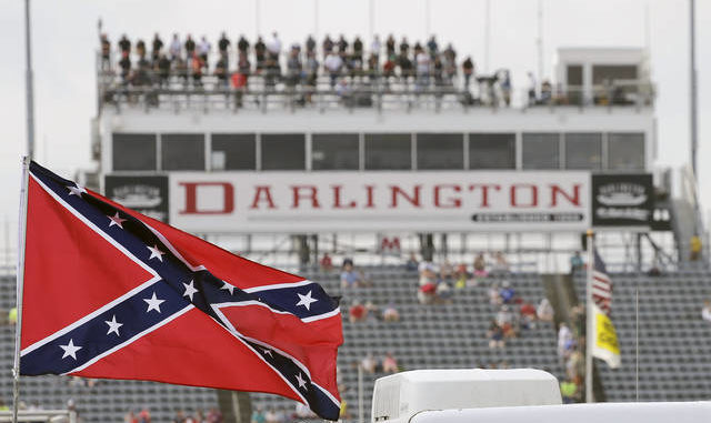 AP Photo | Terry Renna, File                                 A Confederate flag flies in the infield before a NASCAR Xfinity race in 2015.