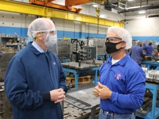 Gavin Stone   Daily Journal                                 Congressman Dan Bishop speaks with Plastek's project manager, Jim Hermann, on Monday.