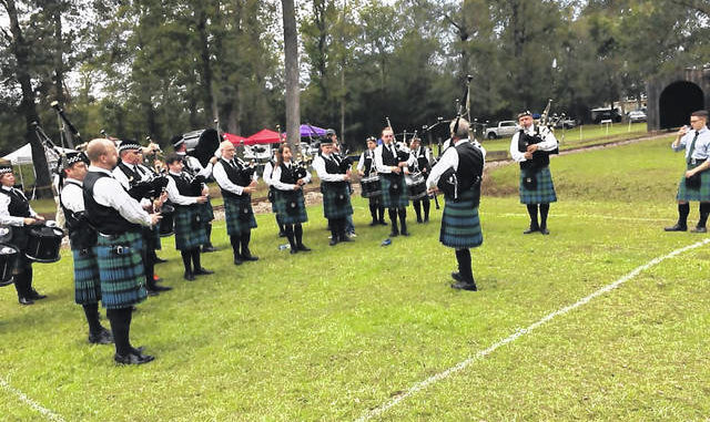 Photo courtesy of J.A. Bolton                                 A bagpipe band plays a tune.