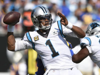 Former Panthers QB Newton signs with Pats