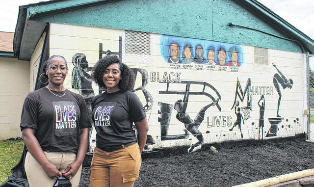 Gavin Stone | Daily Journal                                 Dobbins Heights-natives Annie Renee Harden and Jayla Jasper-Anderson had never met before working on this mural and had never done a project like this, but said they enjoyed working together.