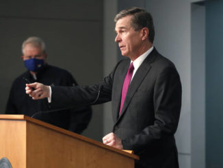 Ethan Hyman| The News & Observer via AP                                 Gov. Roy Cooper answers a question during a briefing at the Emergency Operations Center in Raleigh on Wednesday.