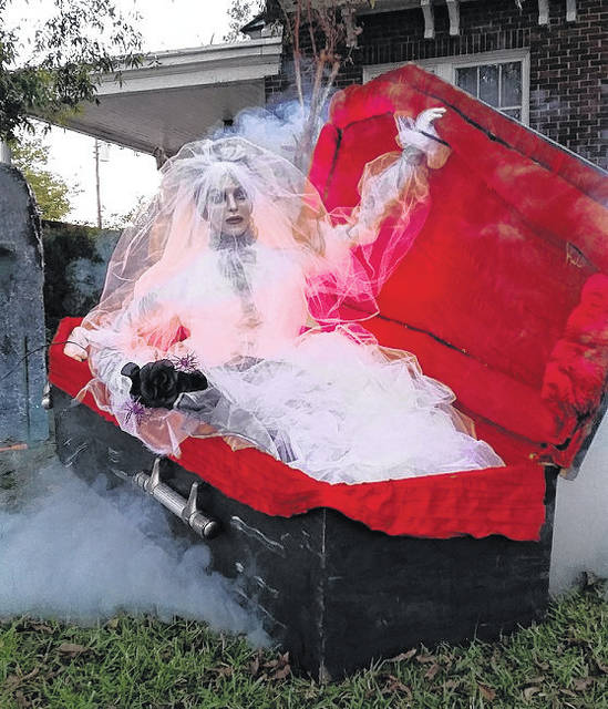 <p>Daily Journal file photo</p>                                 <p>Michael Gamber's extensive Halloween decorations include this coffin given to him by Carter Funeral Home.</p>