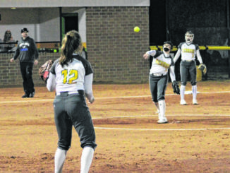 FILE - Paige Ransom (3) throws to Lady Raiders first baseman Madison Jordan (12) during the team's home win over Uwharrie in early March.