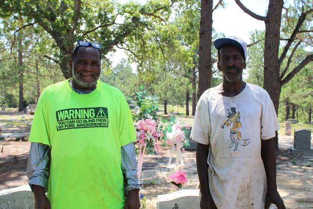 Gavin Stone | Daily Journal                                 Alexander Robinson and Michael Terry at the Dobbins Heights Cemetery on Wednesday.