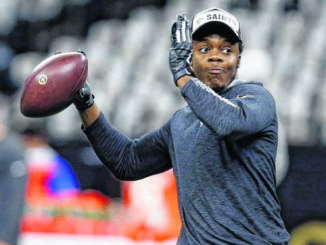 FILE - In this Nov. 24, 2019, file photo, New Orleans Saints quarterback Teddy Bridgewater warms up before an NFL football game against the Carolina Panthers in New Orleans. Not surprisingly some of the biggest focus is at quarterback with Teddy Bridgewater tasked with replacing Newton in Carolina after the former No. 1 pick had a nine-year run as starter for the Panthers.                                  Butch Dill | AP File Photo