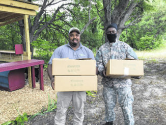 Photo courtesy of Paige Burns Clark                                 Richmond Fresh boxes delivered to the Ellerbe Grove Community.