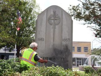 Neel Madhavan | Daily Journal                                 Public works staff cleans black spray paint off of monument in Harrington Square in downtown Rockingham Saturday afternoon.