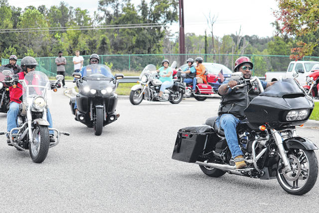 Bikers roll out of the Hwy 55 Burgers, Shakes and Fries parking lot Saturday afternoon as part of a fundraising ride for the Andy's Foundation.                                  Neel Madhavan | Daily Journal