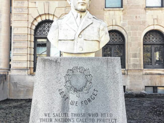 """Photo courtesy of J.A. Bolton                                 """"Lest we forget,"""" reads this statue of a WWII soldier wearing his garrison cap."""