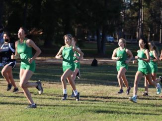 The Richmond Senior High School girls' cross country team takes off at the starting line at Wednesday's meet in Laurinburg.                                  Neel Madhavan | Daily Journal