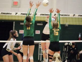 Seniors Georgia Grace Anderson and Shelly Hoffman go up for a block during Thursday's loss to Pinecrest in Southern Pines.                                  Neel Madhavan | Daily Journal