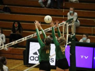 Senior Georgia Grace Anderson (left) and senior Shelly Hoffman go up for a block during a loss to Pinecrest on Nov. 19, 2020.                                  Neel Madhavan | Daily Journal File Photo