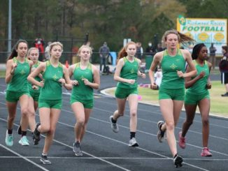 The Lady Raiders run together just after the start of the race during Monday's meet at Richmond Senior High School.                                  Neel Madhavan | Daily Journal