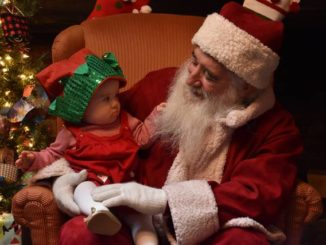 Santa Claus looks to spread joy, not germs, this holiday season