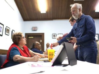 Associated Press file photo                                 An appeals court ruled Wednesday that federal judge wrongly blocked North Carolina's latest photo voter identification law.