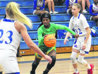 Senior Jayla McDougald splits a double by Scotland's Alyra Parker (12) and Kadence Sheppard (23) during a game last season                                  Brandon Tester | Laurinburg Exchange File Photo