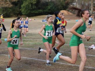Junior Maylyn Wallace (right) and sophomores Rylie Bohman (21) and Sheccid Heaton (24) run off the starting line during Wednesday's Sandhills Athletic Conference meet.                                  Neel Madhavan | Daily Journal