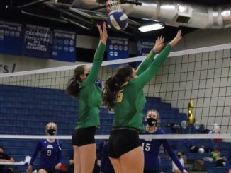 Seniors Georgia Grace Anderson (left) and Taylor Chappell go up for a block at the net Thursday night against Scotland.                                  Neel Madhavan | Daily Journal