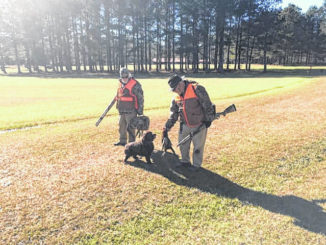 Photo courtesy of J.A. Bolton                                 Pheasant hunters enjoy a day in the field.