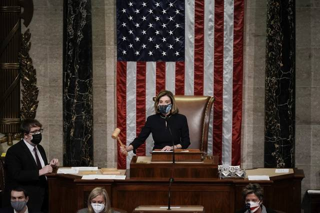 AP Photo | J. Scott Applewhite                                 Speaker of the House Nancy Pelosi, D-Calif., leads the final vote of the impeachment of President Donald Trump, for his role in inciting an angry mob to storm the Congress last week, at the Capitol in Washington, Wednesday, Jan. 13, 2021.