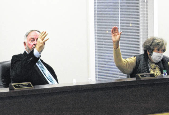 Matthew Sasser | Daily Journal                                 Board Chair Wiley Mabe, left, and board member Bobbie Sue Ormsby voted yes for the decision to carry the motion to allow students to return to in-person instruction.