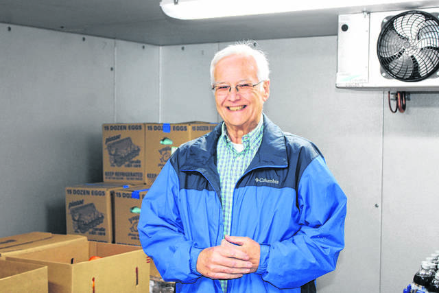 <p>Daily Journal file photo</p>                                 <p>Clyde Smith stands in Our Daily Bread's walk-in cooler.</p>