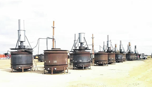 Photo courtesy of NCDEQ                                 This picture shows an example of a row of pyrolysis kilns that will be used to produce biochar in a similar setup to what will be used by ITD.