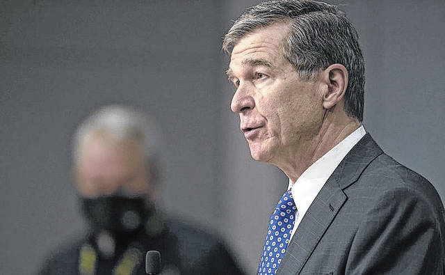 North Carolina Governor Roy Cooper speaks during a press briefing on the COVID-19 virus, vaccination efforts, winter storms and schools reopening on Thursday, Feb. 18, 2021 at the Emergency Operations Center in Raleigh, N.C.                                  Robert Willett | AP Photo