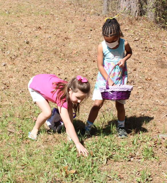 <p>Gavin Stone   Daily Journal</p>                                 <p>Patience Oxendine, left, and Aliana split a group of eggs they found on Easter Sunday. </p>