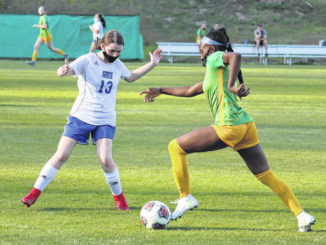 Richmond forward senior Jayla McDougald dribbles upfield against Scotland midfielder freshman Campbell Gross during Tuesday's game.                                  Neel Madhavan | Daily Journal & Laurinburg Exchange
