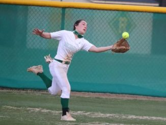 Junior Kenleigh Frye makes a running catch in center field in the top of the third inning during a game against Jack Britt earlier this season.                                  Neel Madhavan | Daily Journal File Photo