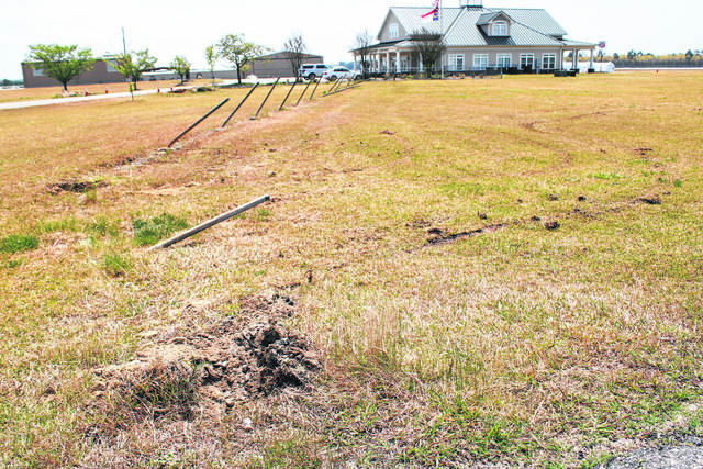Gavin Stone | Daily Journal                                 This is the point of impact just to the left of the entrance to the runway where the suspect rammed the fence. The poles of the fence were bent backwards by the impact.
