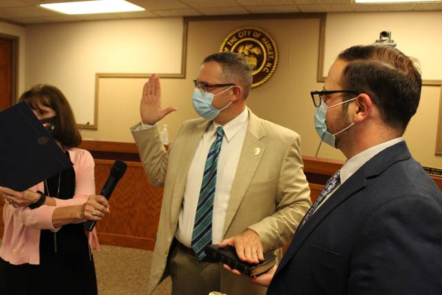 Gavin Stone | Daily Journal                                 Dennis Brown takes his oath of office, with Hamlet City Manager Matthew Christian holding the Bible and City Clerk Gail Strickland reciting the oath.