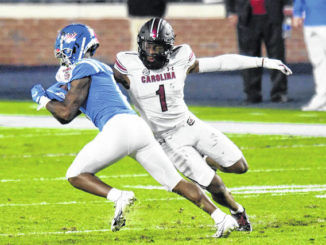 FILE - Mississippi wide receiver Elijah Moore is tackled by South Carolina defensive back Jaycee Horn (1) during the first half of an NCAA college football game in Oxford, Miss., Saturday, Nov. 14, 2020.                                  Bruce Newman | AP File Photo