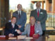 Photo courtesy of Richmond Community College                                 Dr. William M. Downs, president of Gardner-Webb University, and Kevin Parsons, vice president of instruction for Richmond Community College, shake hands after signing the Bulldog Bound co-admission agreement. Standing in back, from left, are Dr. Ben Leslie, provost and executive vice president for Gardner Webb, and Brent Barbee, executive vice president/CFO for RichmondCC.
