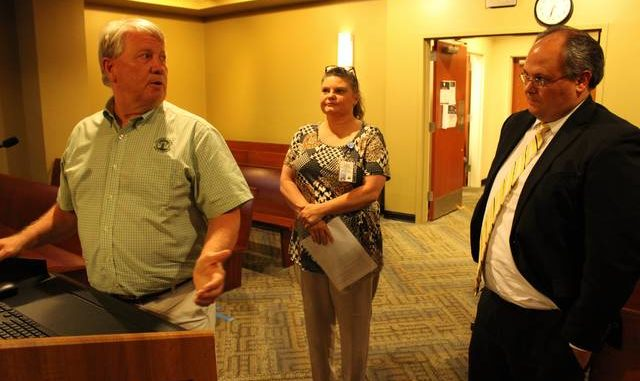 Gavin Stone | Daily Journal                                 From left, Richmond County Information Technology Director Jimmy Quick, Public Health Educator Kendra Faries, and Lumber River Council of Governments Executive Director David Richardson speak to the Board of Commissioners about the broadband access study.