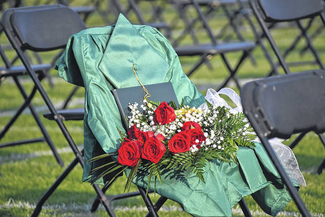 Two chairs were decorated with a cap and a gown at the Raider graduation to honor the lives of Jacob Hughes and Travis Nelson.                                  Photo courtesy of Richmond County Schools