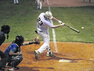 Hamlet's Jake Clemmons (23) hits a two-RBI single Tuesday night against Port City Post 545 at Memorial Park.                                  Neel Madhavan | Daily Journal