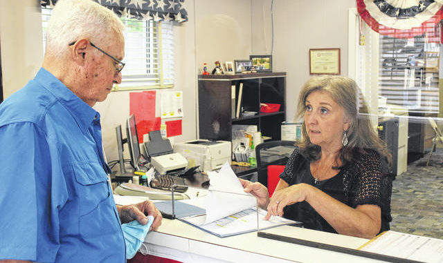 Daily Journal file photo                                 Bill Bayless files for reelection as Mayor of Hamlet with Board of Elections Director Connie Kelly.