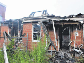 Fire topples roof of abandoned Rockingham structure