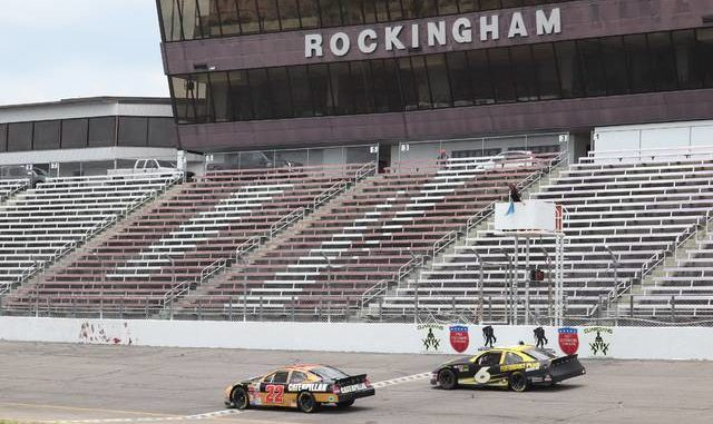 Two former NASCAR stock cars cross the finish line at Rockingham Speedway Saturday.                                  Neel Madhavan | Daily Journal