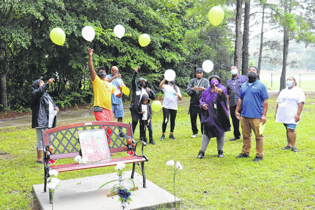 Immediate family members release balloons into the air in honor of the family of four that perished in the accident on July 2.                                  Neel Madhavan | Daily Journal